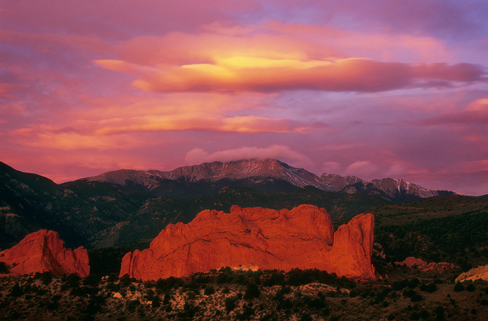 A pink sunrise over Garden of the Gods and Pikes Peak