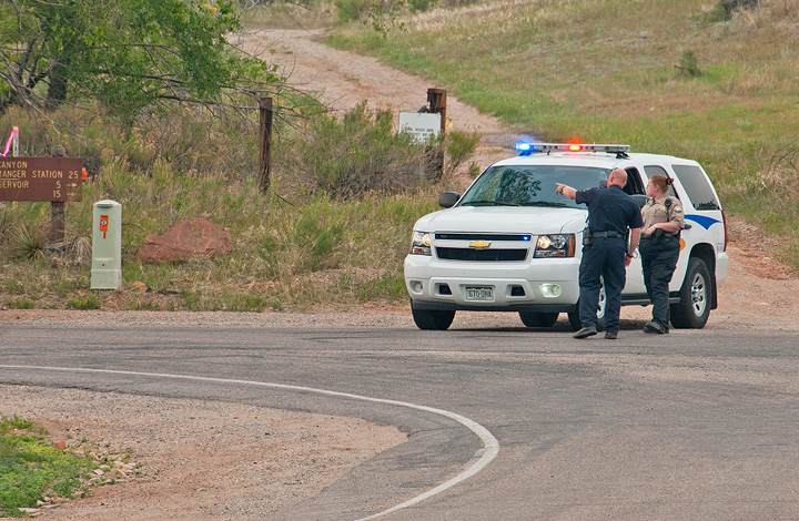 Larimer County Sheriff's Deputies work at a Masonville roadblock.