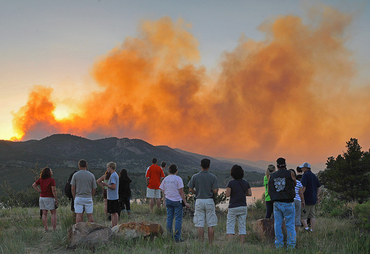 Onlookers watch air crews battle the blaze from the shores of Horsetooth Reservoir.
