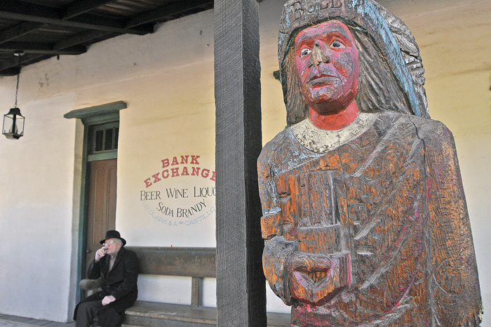 Cigar store Indian in front of an Old Town store.